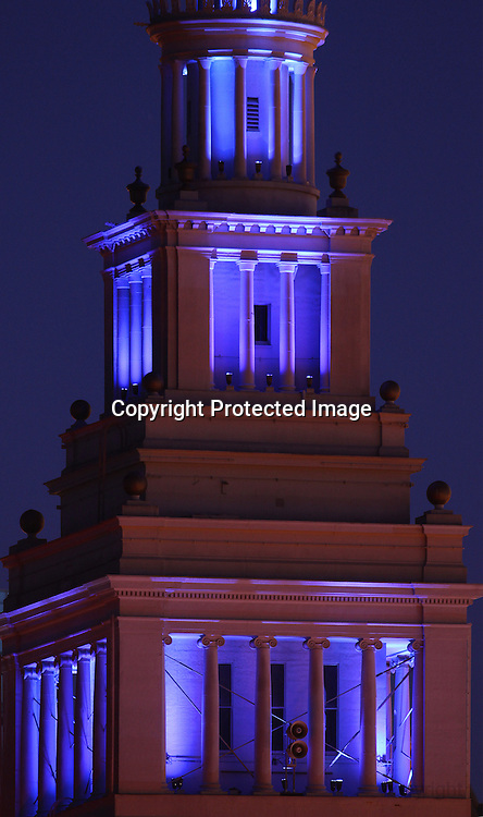 The San Francisco Ferry Building lighted in blue.