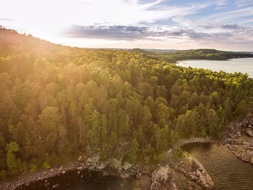 Aerial drone shot of rugged Lake Superior shoreline near Marquette, Michigan.