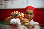 Antonia Carvalho scoops Goiabada com Queijo ice cream - guava with cheese - at Mil Frutas in the Leblon neighborhood, in Rio de Janeiro, Brazil, on Saturday, Feb. 2, 2013.