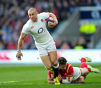 Mike Brown of England looks to get past Alex Cuthbert of Wales. RBS Six Nations match between England and Wales on March 12, 2016 at Twickenham Stadium in London, England. Photo by: Patrick Khachfe / Onside Images