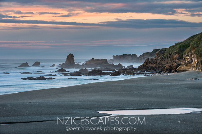 Twilight on wild beach near Punakaiki, Paparoa National Park, Buller Region, West Coast, New Zealand, NZ