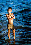 A boy makes the most of a temporary swimming hole during the monsoon season flooding in Southern Laos.