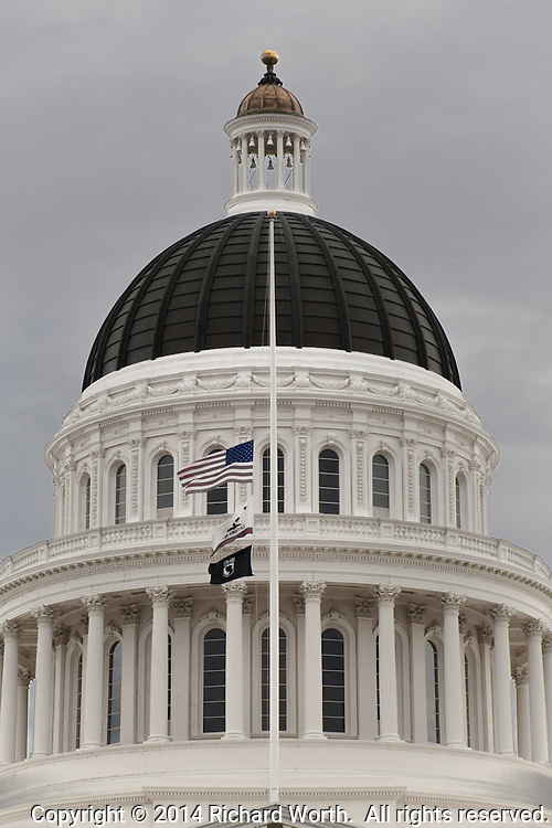 Flags at the California State Capitol flying at half-staff in recognition of  Pomona Police Department Officer Shaun Diamond who was shot while serving a search warrant.  He died Oct. 29, 2014.