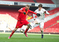 LIVERPOOL, ENGLAND - Easter Monday, April 1, 2013: Liverpool's Kristoffer Peterson in action against Tottenham Hotspur's Kenneth McEvoy during the Under 21 FA Premier League match at Anfield. (Pic by David Rawcliffe/Propaganda)