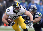 Pittsburgh Steelers tight end Heath Miller (83) is tackled by Seattle Seahawks linebacker Bobby Wagner (54) at CenturyLink Field in Seattle, Washington on November 29, 2015.  The Seahawks beat the Steelers 39-30.      ©2015. Jim Bryant Photo. All Rights Reserved.