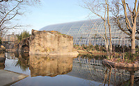 The restored Gibbon's Island in the tropical forest of the Zone Madagascar-Guyane, with the Great Glasshouse behind, at the new Parc Zoologique de Paris or Zoo de Vincennes, (Zoological Gardens of Paris or Vincennes Zoo), which reopened April 2014, part of the Musee National d'Histoire Naturelle (National Museum of Natural History), 12th arrondissement, Paris, France. Picture by Manuel Cohen