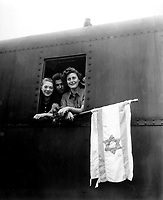 These Jewish children are on their way to Palestine after having been released from the Buchenwald Concentration Camp.  The girl on the left is from Poland, the boy in the center from Lativa, and the girl on right from Hungary.  June 5, 1945. T4c. J. E. Myers. (Army)<br /> Exact Date Shot Unknown<br /> NARA FILE #:  111-SC-207907<br /> WAR &amp; CONFLICT BOOK #:  1262