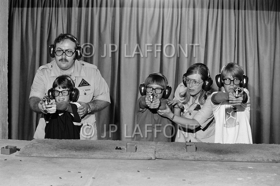 College Station, TX. June 1981.<br /> Children are taught how to handle firearms at a special school created by the retired colonel Sid Loveless. Parents send their children for special shooting courses at a younger and younger age.