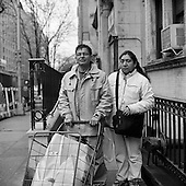March 10, 2009.New York, New  York.USA..The West Side Campaign Against Hunger food pantry and kitchen distributes food for free in a grocery store style. The volunteers who work at the pantry see many new people coming as the economic crisis creates greater unemployed amongst the lower middle class in the United States. ..Raul, 50 yrs, and his wife Mariana Chiriboga come for the first time to the food pantry to obtain free items. He worked in a Greek Restaurant for the past 17 years and has been unemployed for the past 4 weeks for the first time in his life.