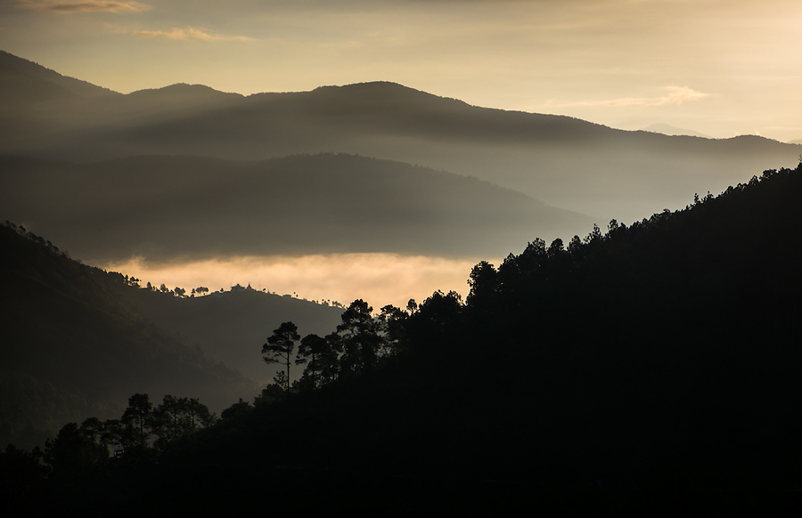 THIMPHU, BHUTAN - CIRCA October 2014: Sunrise over the mountains in Thimphu, Bhutan
