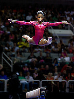Gabrielle Douglas of Dynamic competes on the beam during the 2012 US Olympic Trials competition at HP Pavilion in San Jose, California on June 29th, 2012.