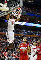 Ohio State Buckeyes forward Sam Thompson (12) slams home a dunk in the second half of the second-round NCAA Tournament game between the Ohio State Buckeyes and the Dayton Flyers at the First Niagara Center, Thursday afternoon, March 20, 2014. The Dayton Flyers defeated the Ohio State Buckeyes 60 - 59. (The Columbus Dispatch / Eamon Queeney)