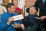 St Johnstone players visit Fairview School in Perth.....19.12.13<br /> Stevie Banks is pictured playing pass the parcel with Alan Lowry<br /> Picture by Graeme Hart.<br /> Copyright Perthshire Picture Agency<br /> Tel: 01738 623350  Mobile: 07990 594431