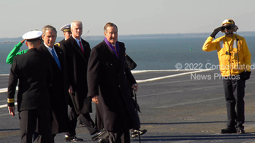 Norfolk, VA - January 10, 2009 -- United States President George W. Bush and former President George H.W. Bush greet crewmembers of the aircraft carrier USS George H.W. Bush (CVN 77) at Naval Station Norfolk, Virginia during the ship?s commissioning ceremony. George H.W. Bush delivered the keynote address at the commissioning. The Navy's newest, and final, Nimitz-class aircraft carrier is named after the World War II naval aviator and 41st president of the United States. .Credit: Demetrius Patton - U.S. Navy via CNP