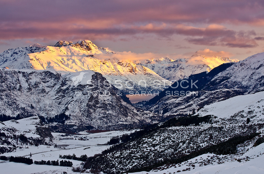 Winter sunset on Walter and Cecil Peaks, Queenstown, seen from Coronet Peak road, South Island, New Zealand.
