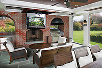 Outdoor Living Area With Ceiling Drop Down TV
