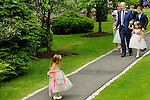 After their ceremony, <br /> the bride and groom share the happy moment with five of their eight grandchildren on a path outside Scarborough Presbyterian Church.