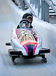 18 December 2010: Bree Schaaf crosses the finish line, finishing in 5th place for the USA at the Viessmann FIBT World Cup Bobsled Championships on Mount Van Hoevenberg in Lake Placid, New York, USA. Mandatory Credit: Ed Wolfstein Photo
