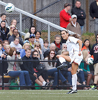 Boston College midfielder Coco Woeltz (2) clears the ball.   University of North Carolina (blue) defeated Boston College (white), 1-0, at Newton Campus Field, on October 13, 2013.