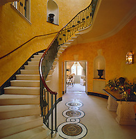 The Inner Hall has a graceful stone staircase with a sweeping banister and the walls have been treated with a rich paint effect