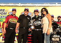 Mar. 13, 2011; Gainesville, FL, USA; NHRA top fuel dragster driver Del Worsham and wife Connie Worsham(right), team owner Allan Johnson (center) and crew chief Brian Husen celebrate after winning the Gatornationals at Gainesville Raceway. Mandatory Credit: Mark J. Rebilas-