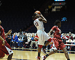 "Ole Miss' Pa'Sonna Hope (15) shoots as Arkansas' Quistelle Williams (24) defends at the C.M. ""Tad"" Smith Coliseum in Oxford, Miss. on Thursday, January 12, 2012."