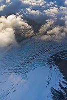 Aerial of clouds over the Muldrow glacier winding out from Mount McKinley, North America's tallest peak.