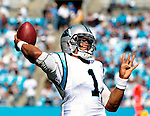 Carolina Panthers quarterback Cam Newton (1) throws downfield during the game between the Dallas Cowboys and the Panthers.Sunday, October 21, 2012 in Charlotte, N.C. (AP Photo/Margaret Bowles)