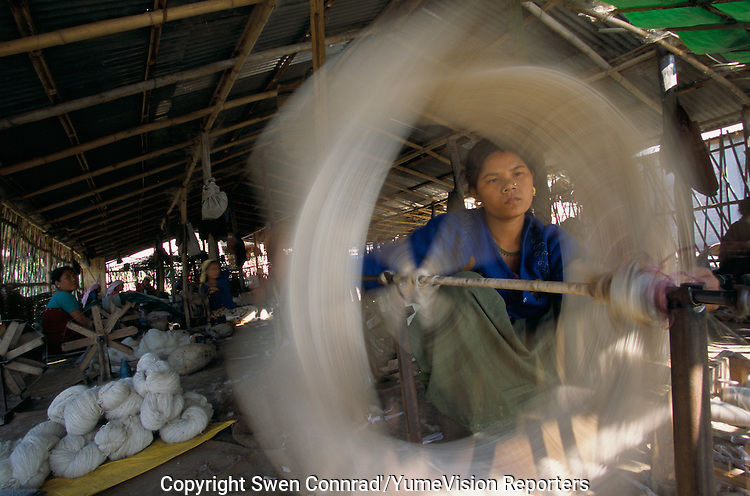 Under UNHCR protection, the life of 135000 Bhutanese refugees in one of the 7 camp (near Damak, Nepal). Womans and mens are spinning woollen for few rupees..-The full text reportage is available on request in Word format