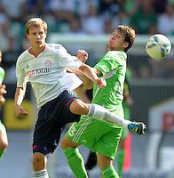 FUSSBALL   1. BUNDESLIGA   SAISON 2011/2012    2. SPIELTAG VfL Wolfsburg - FC Bayern Muenchen      13.08.2011 Holger BADSTUBER (li, Bayern) gegen Patrick HELMES (re, Wolfsburg)