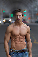 sexy man without a shirt in New York shirtless man with a very toned and muscular body outdoors in New York City