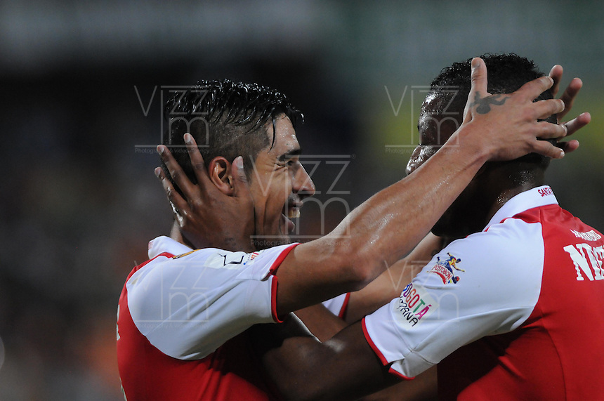 MEDELLÍN -COLOMBIA-03-08-2013. Jugadores del Santa Fe celebran un gol en contra de Nacional durante partido de la fecha 2 de la Liga Postobón II 2013 jugado en el estadio Atanasio Girardot de la ciudad de Medellín./ Santa Fe Players celebrates a goal against Nacional during match on the 2th date of the Postobon League II 2013 at Atanasio Girardot stadium in Medellin city.  Photo:VizzorImage/Luis Ríos/STR