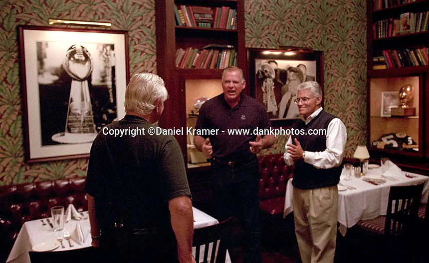 Dick Schaap, left, and Vince Lombardi Jr., right, watch as Jerry Kramer does his best Vince Lombardi imitation during a reunion of Lombardi's players at the Lombardi Steakhouse in Appleton, Wisconsin in September of 2001.