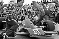 INDIANAPOLIS, IN - MAY 27: AJ Foyt (center) oversees pit stop practice for crew members of his Parnelli VPJ6C 005/Cosworth TC before the Indy 500 at the Indianapolis Motor Speedway in Indianapolis, Indiana, on May 27, 1979.