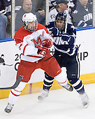 Will Weber (Miami - 4), Austin Block (UNH - 3) - The University of New Hampshire Wildcats defeated the Miami University RedHawks 3-1 (EN) in their NCAA Northeast Regional Semi-Final on Saturday, March 26, 2011, at Verizon Wireless Arena in Manchester, New Hampshire.