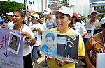Maria de Jesus Silva Velasquez holds photos of disappeared family members during a December 16, 2013 demonstration in the southern Mexico city of Tapachula.<br /> <br /> A Nicaraguan, Silva was part of a caravan of 45 people from Central America who spent 17 days touring 14 Mexican states in search of their loved ones, most of whom had disappeared while following the migrant trail north. <br /> <br /> Silva holds photos of her daughter Jacqueline Silva Giron, who was kidnapped by traffickers in 2004 at the age of 11. Silva has identified the woman responsible for the abduction, but has been unable to locate her daughter for nine years. The second photo she holds is of her nephew Humberto Mayorga Silva, who left in 2007 when he went to search for Silva's daughter. He last called in 2011 but hasn't been heard from since.