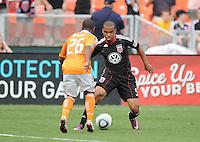 DC United forward Charlie Davies (9) goes against Houston Dynamo defender Corey Ashe  (26)   Houston Dynamo tied DC United 2-2, at RFK Stadium, Saturday June 25, 2011.