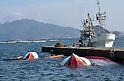 April 1st, 2011, Yamadamachi, Japan - Capsized boats remain unattended in the fishing port of Yamadamachi, Iwate Prefecture, on April 1, 2011, three weeks after this otherwise sleepy northeastern Japanese fishing vilalge was devastated by a magnitude 9.0 earthquake and ensuing tsunami. (Natsuki Sakai/AFLO) [3615] -mis-.