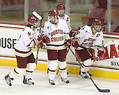 Melissa Bizzari (BC - 4), Danielle Welch (BC - 17), Katelyn Kurth (BC - 14) and Kelli Stack (BC - 16) celebrate Stack's third goal. - The Boston College Eagles defeated the visiting Harvard University Crimson 6-2 on Sunday, December 5, 2010, at Conte Forum in Chestnut Hill, Massachusetts.