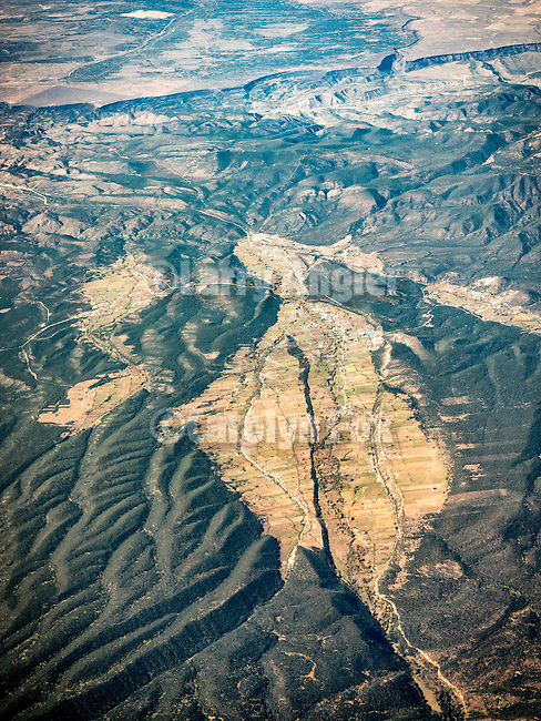 Picuris Pueblo flying over the mountains and valleys north of Santa Fe, New Mexico, from a window seat.