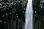 Black Falls cascades over basalt cliffs in Skaftafell National Park in Iceland.