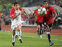 Costa Rica's Cristian Gamboa (12) races for the ball against Egypt's Hussam Arafat (20) during the FIFA Under 20 World Cup Round of 16 match at the Cairo International Stadium on October 06, 2009 in Cairo, Egypt.