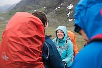 Group of hikers on rainy day near Tjäktja pass, Kungsleden trail, Lapland, Sweden