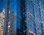 Reflections in the glass facade of the Intercontinental Hotel building in the Financial District of Boston, MA, USA
