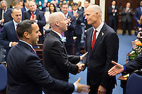 TALLAHASSEE, FLA. 11/18/14-ORGSESS111814CH-Rep. Evan Jenne, D-Dania Beach, left, greets Gov. Rick Scott after taking the oath of office during Organizational Session, Nov. 18, 2014 at the Capitol in Tallahassee.<br /> <br /> COLIN HACKLEY PHOTO