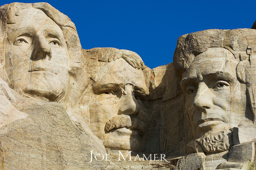 Close up view of Thomas Jefferson, Theodore Roosevelt, and Abraham Lincoln at Mount Rushmore National Memorial.