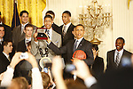 UK freshman Anthony Davis and President Barack Obama hold up the first UK national championship ring made, presented to Obama as a gift during the UK National Championship Celebration in the East Room of the White House, in Washington D.C., May 4, 2012. Photo by Brandon Goodwin | Staff