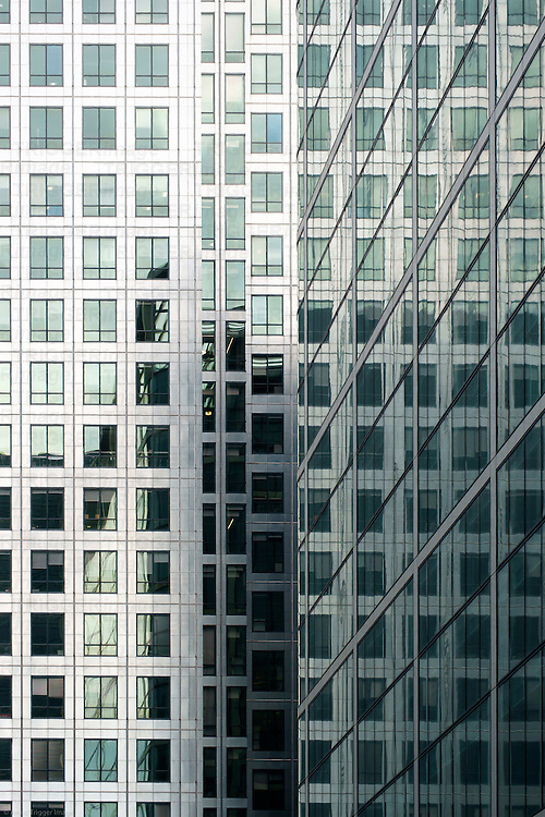 The abstract photograph of skyscraper reflections in a high-rise building.