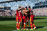 Luke Mulholland (19) of Real Salt Lake celebrates scoring with teammates during a Major League Soccer (MLS) match at PPL Park in Chester, PA, on April 12, 2014.