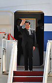 Chinese President Hu Jintao waves as he arrives for the Nuclear Security Summit, at Andrews Air Force Base, Maryland, April 12, 2010.  .Credit: Kevin Dietsch / Pool via CNP